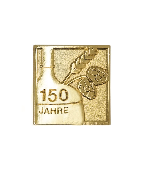 Pins und Anstecker geprägt in Sandkorn - Optik zum Jubiläum 150 Jahre